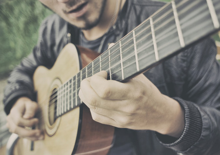 playing guitar: Man playing a guitar