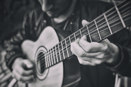melodies: Man playing a guitar