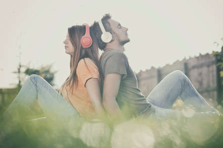 music listening: Boy and girll listening to music on headphones Stock Photo