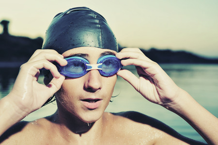 submerge: A young boy swimming in sea, close up Stock Photo