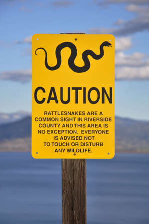 Warning sign along a hiking trail at Diamond Valley Lake in Hemet, California. photo