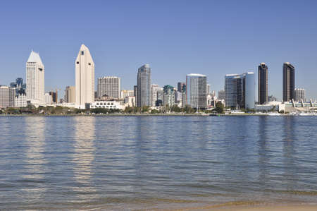 diego: Office towers reflect in the water of San Diego Bay. Stock Photo