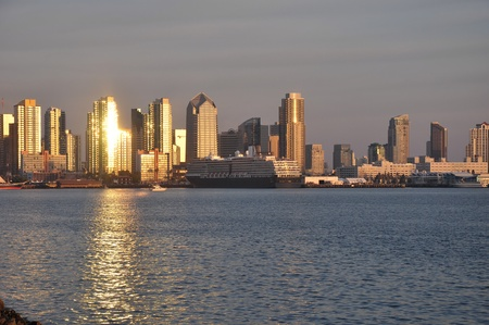 Late afternoon sunlight reflects off of downtown towers in San Diego.  photo