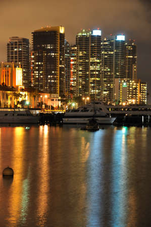 reflect: Lights from downtown towers reflect in the water of San Diego Bay.