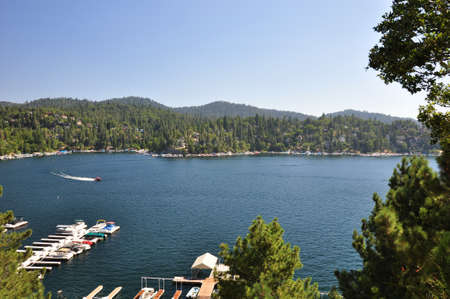 marina bay: A speed boat glides across Lake Arrowhead in Southern California.