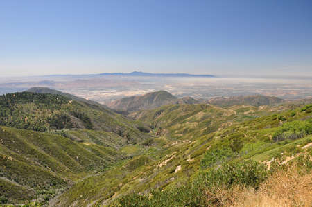 valley below: Smog rests over the valley below in Southern California.