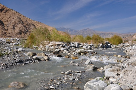 high desert: Rushing water flows through the desert at Whitewater Canyon near Palm Springs, California.