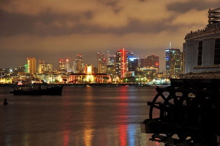An old paddle wheel boat frames this nighttime view of downtown San Diego, California. photo