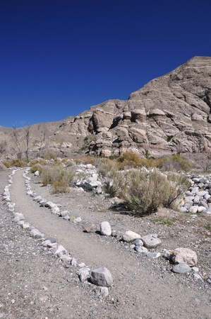 mirage: Rocks line a trail through the desert in Whitewater Canyon near Palm Springs, California  Stock Photo