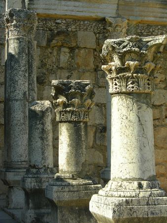 deference: The columns of ancient sinagoge, Capharnaum, lake Kineret, Israel( Capharnaum the tower of Jesus, the house of Simon Peter) Stock Photo