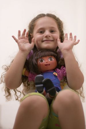 young girl with doll on white background Stock Photo - 537465
