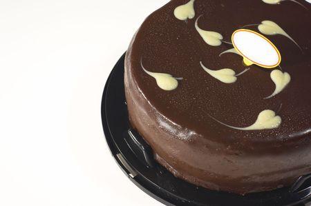 chocolate cake clouse-up on white background photo