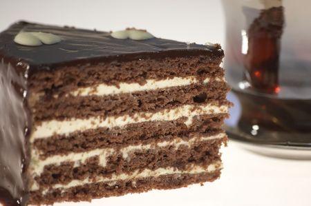 indulgent: chocolate cake clouse-up on white background