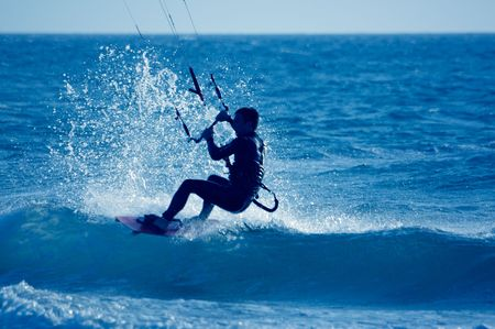 kite surfing, silhouette of sportsmen on blue Stock Photo - 948750