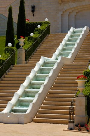steps path and  stream of Bahai Temple, sepulchre of Baba, founder of bahaism, Haifa, Israel photo