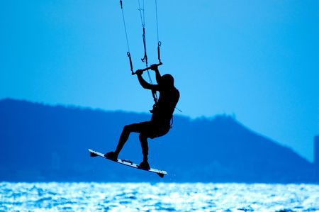 kite surfing, silhouette of sportsmen on blue Stock Photo - 2910121