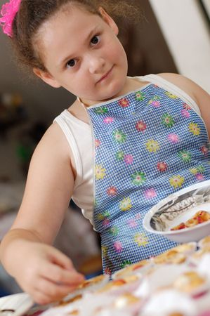 cute young chef on a domestic kitchen photo