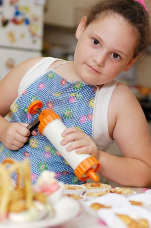 cute young chef on a domestic kitchen Stock Photo - 3173006