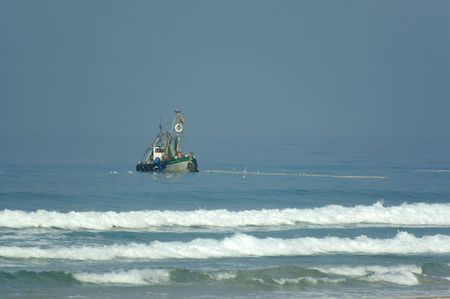 fishing boat in a sea photo