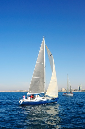 yacht race: Racing yacht in the mediterranean sea on blue sky background.