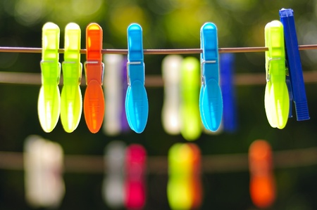 Multicolored clothes pin on rope photo