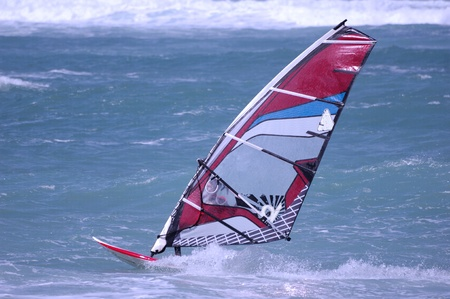outdoor pursuit: Windsurfing on a beach of Mediterranean sea