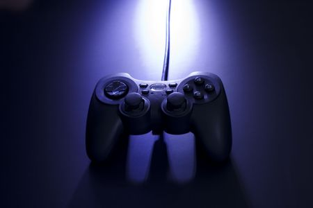 A video game joystick with dramitic lighting