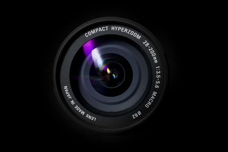 A camera zoom lens on a black background Stock Photo