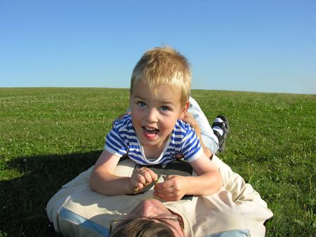 son lie on ather on green grass Stock Photo - 249001