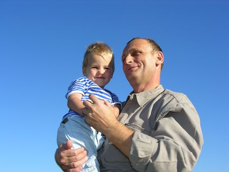 grandfather with grandson smiling slyly Stock Photo - 259856
