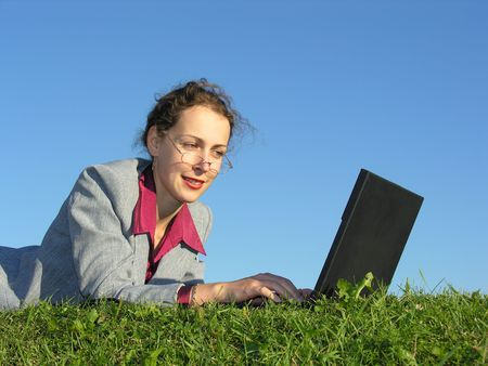 businesswoman face with notebook on blue sky