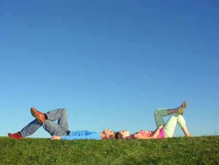 couple lie on blue sky Stock Photo