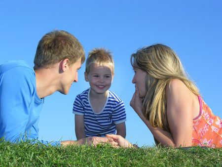 family on grass faces Stock Photo - 259573