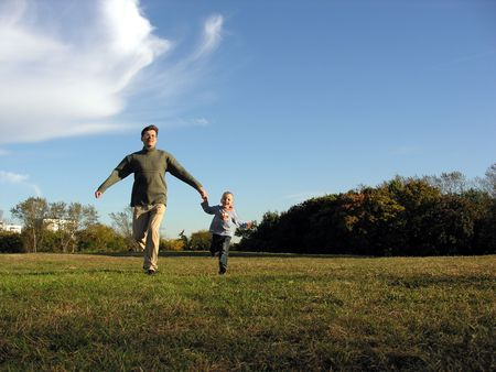 father with sun running autumn