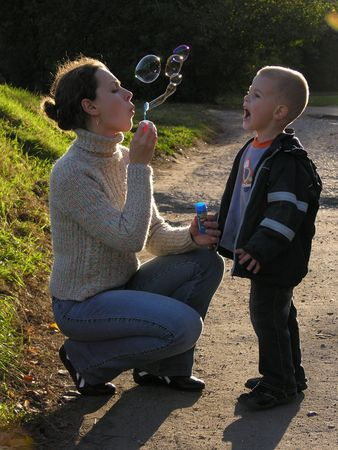 soapy: mother with son on sundown with soapy bubble