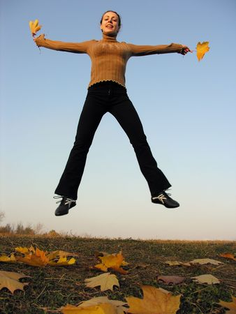 jump girl with autumn leaves photo