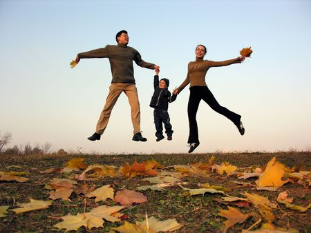 fly happy family with autumn leaves photo