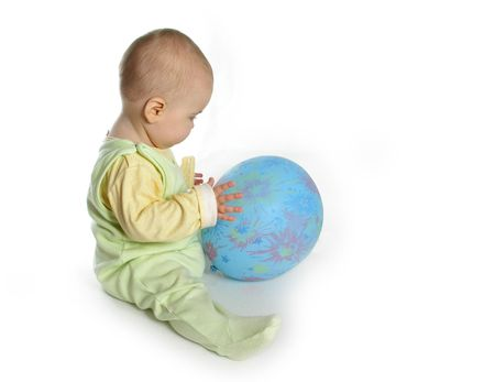 baby with balloon on white