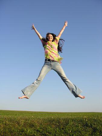 jump girl with hair on sky 2 Stock Photo