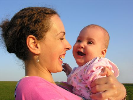 faces mother with baby on sunset Stock Photo - 327976