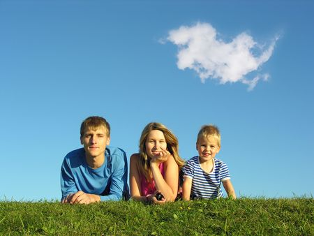 family on herb under blue sky photo