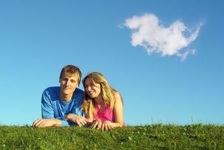 untruth: couple lies on meadow with cloud