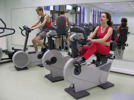 cardiovascular workout: healthclub. boy and girl