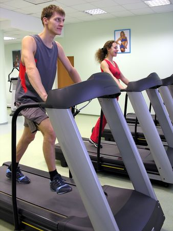 cardiovascular workout: girl and boy in health club Stock Photo