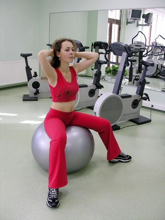 cardiovascular exercising: girl in health club on rubber ball Stock Photo