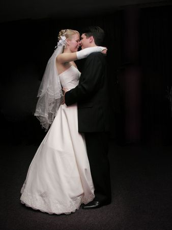 bride and groom dancing in the dark photo