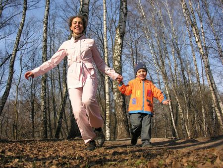 boy with mother run in park. spring. Stock Photo