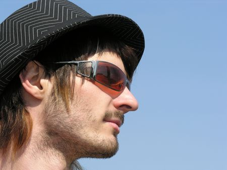boy with hat and sunglasses photo