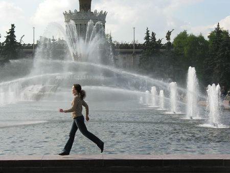 wet jeans: running girl at fountain