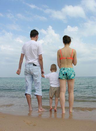 back family of three. beach. photo
